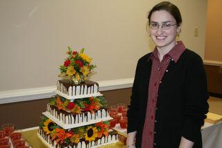 Sarah with the wedding cake