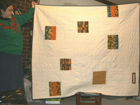 Whimsical back of the Piece of Cake quilt