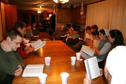 gathered round singing