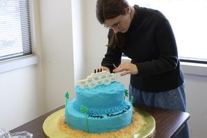 Placing the cruise ship on the cake