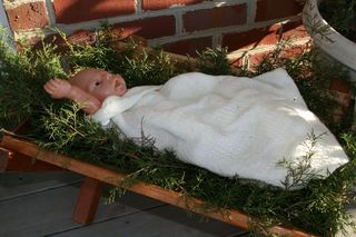 Baby lying in a manger