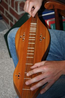 Jonathan and his yard sale acquired mountain dulcimer