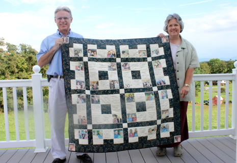 Tom and Deb holding their 30th anniversary quilt