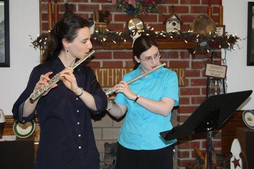 Hannah & Sarah practice flutes