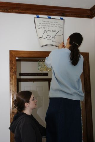 Hannah & Sarah putting scripture on the wall