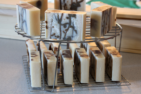 chocolate soap curing on racks