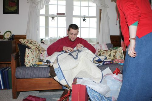 Jonathan finding the label on his quilt
