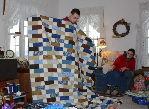 Jonathan holding his quilt ~ I think he likes it!