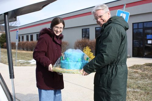 Sarah and Dad delivering cake
