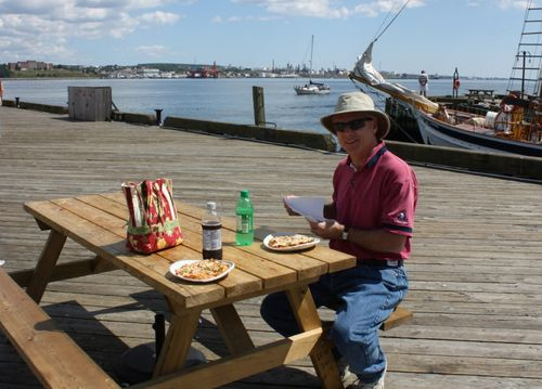 Sitting on the dock eating pizza in Nova Scotia