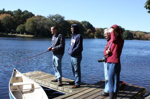 Jonathan, cousin Eric, Grampa, and Hannah watch for fish!