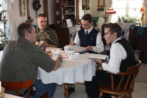 the young men open their Bibles and discuss the scriptures