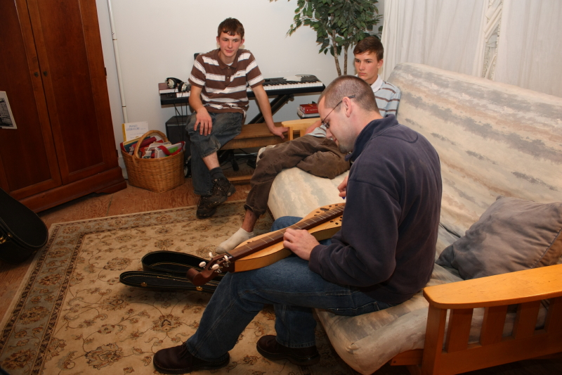 Jonathan and the Toms guys listen to dulcimer music