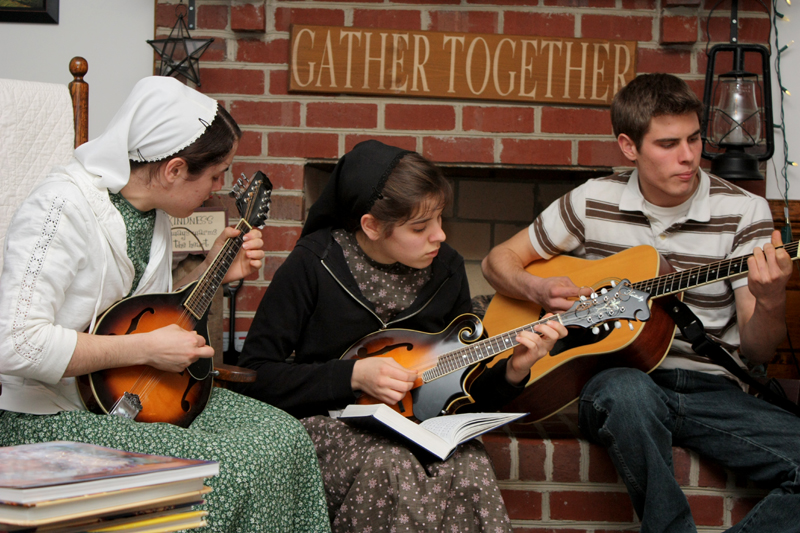 siblings playing instruments