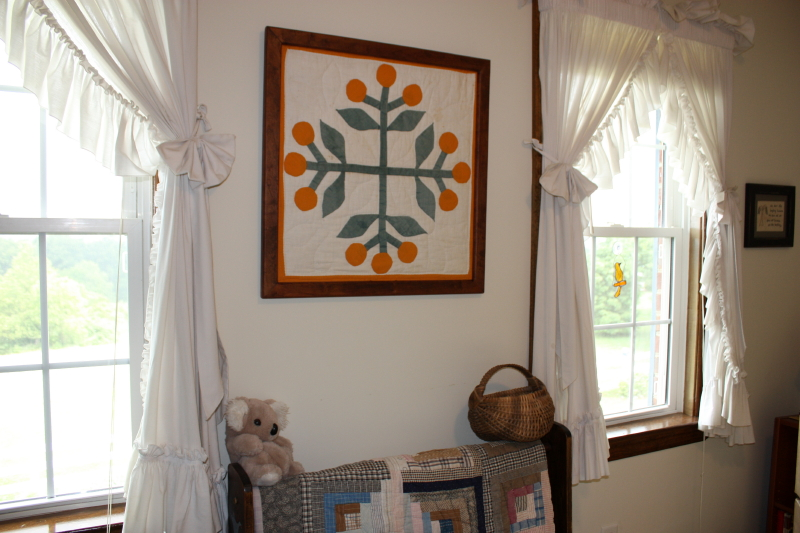 Another view ~ antique quilt block in guest room
