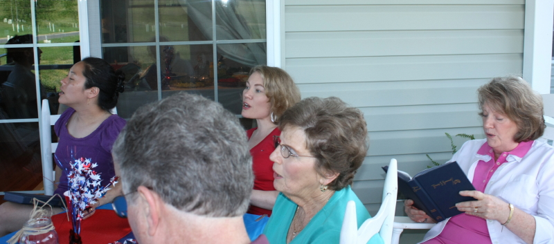 Kendra (back middle), her mom (right), and her guests singing