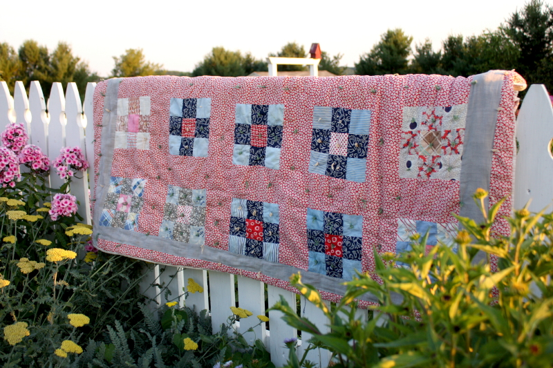 Vintage quilt on a picket fence