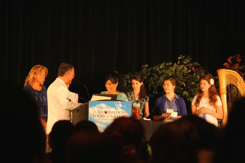Winners receiving their checks
