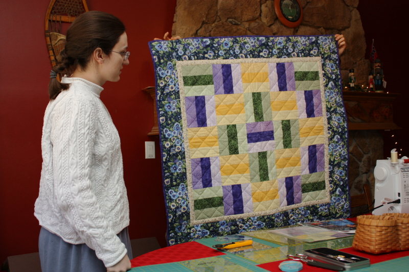 Hannah behind the Rail Fence Quilt