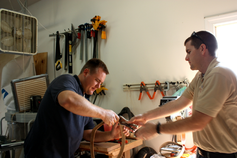 Erich works on another handle while Kyle takes a turn holding it in place.