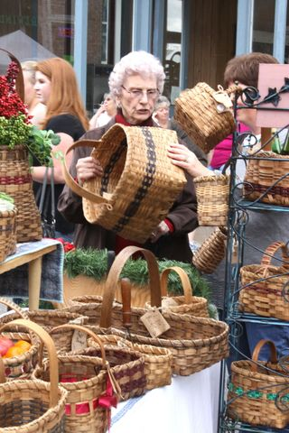Granny showing the reinforced weaving on the bottom of her baskets