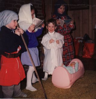 Jonathan as the shepherd, Hannah as Mary, Sarah as the angel, and Micah as Joseph. And a baby doll in a pink plastic cradle as Jesus in the manger. :)