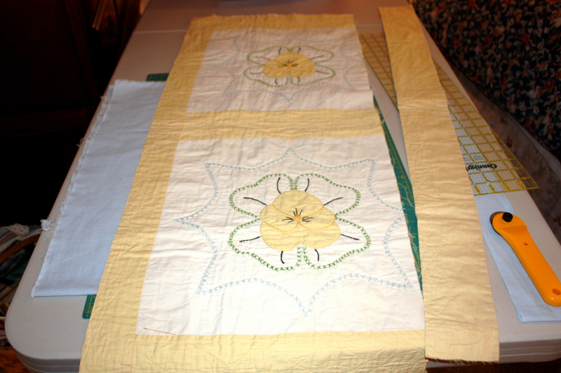 Quilt in process of having border sewn on