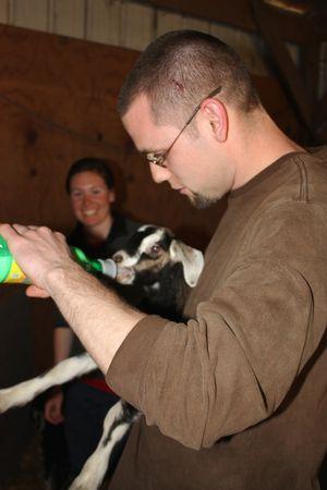 Jonathan feeds a newborn ~ homeschoolers never stop learning! :)