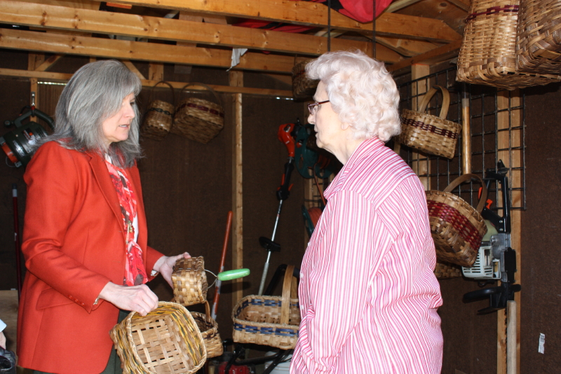 Lisa and Granny looking at baskets