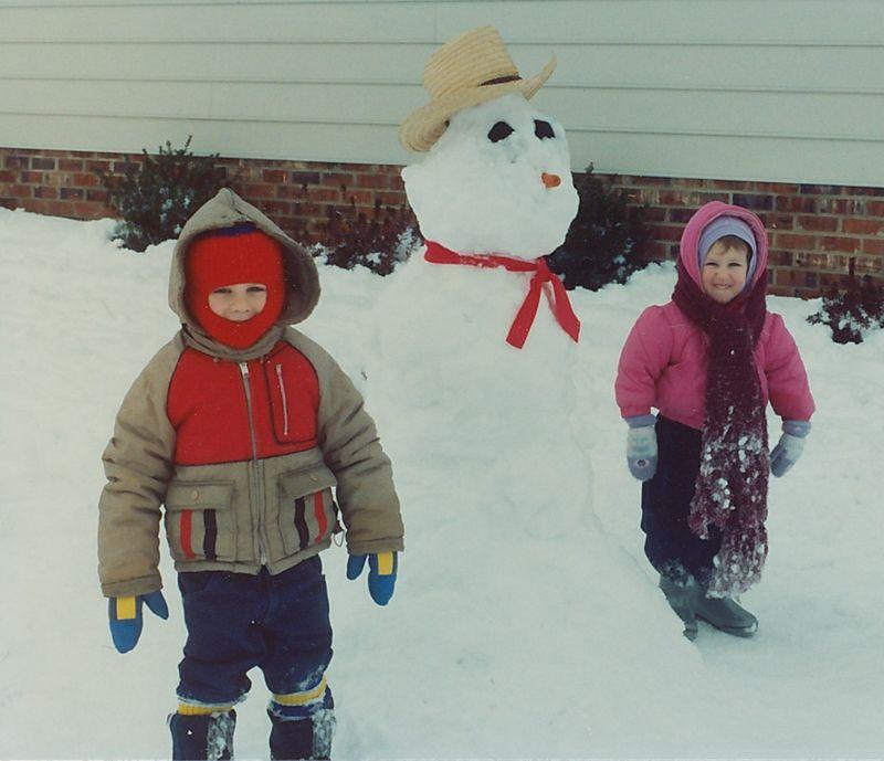 Jonathan and Sarah next to a snowman in Mechanicsville, VA