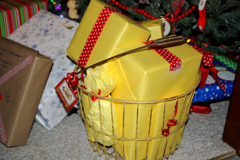 A yellow egg basket filled with yellow gifts for my sister