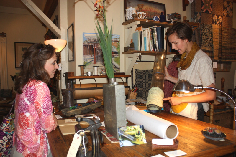 Chris listens as Nellie explains how she cuts the dress off the tubing.