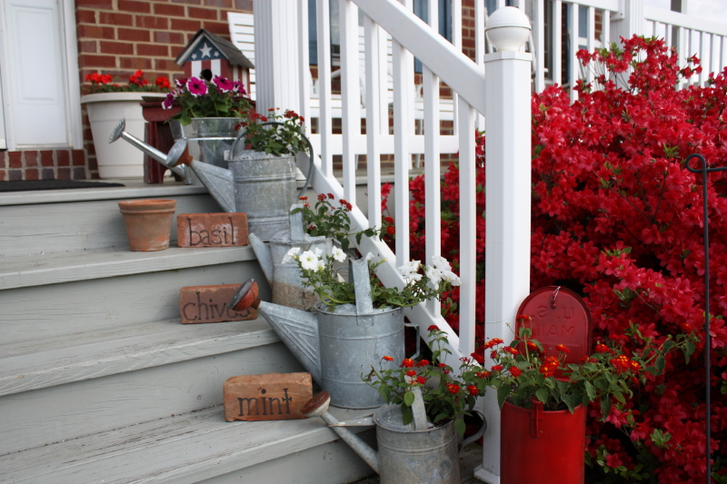 Front porch watering cans