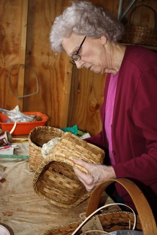 Granny wiping the baskets clean