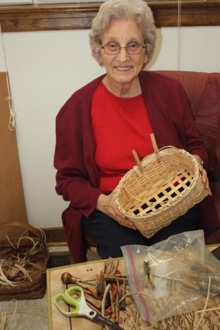 Granny working on her tissue basket