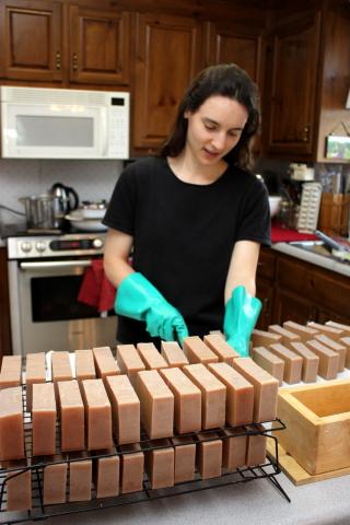 Hannah cutting dirt soap
