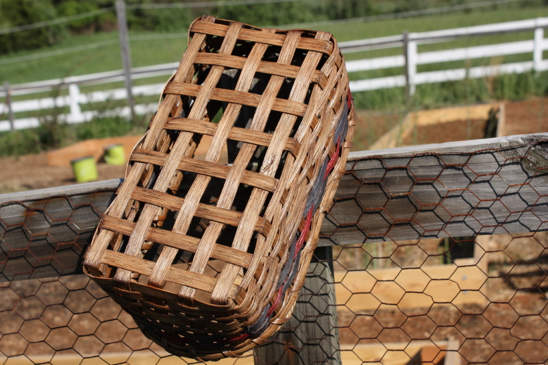 napkin basket drying on garden fence