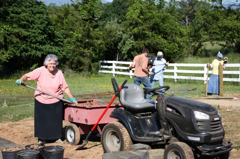 Deb shoveling topsoil
