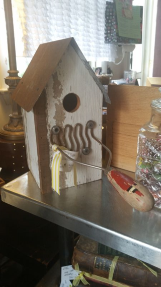 Birdhouse with potato masher as perch