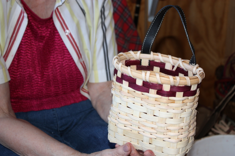 Wall basket with pocketbook strap