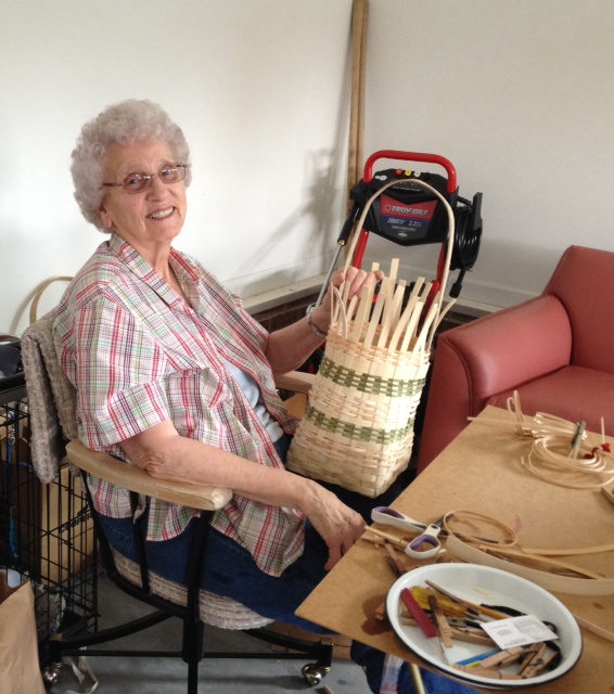 Granny in the garage making baskets