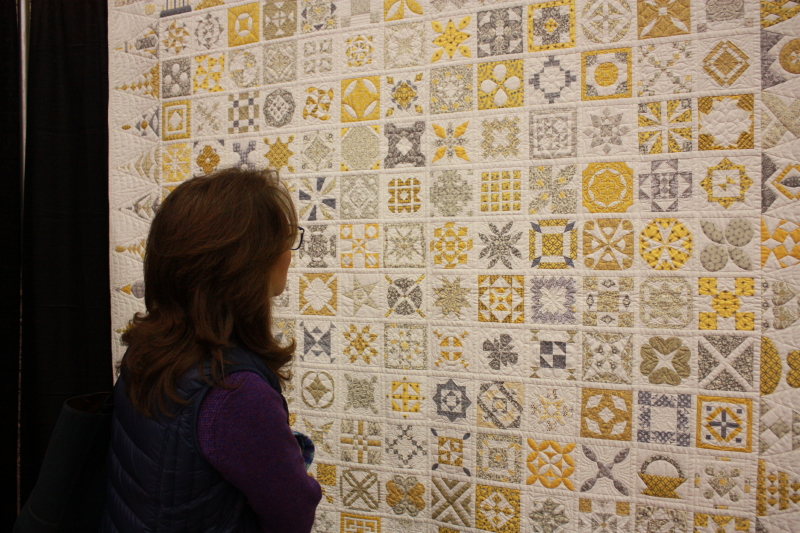 Chris looking at one of the quilts