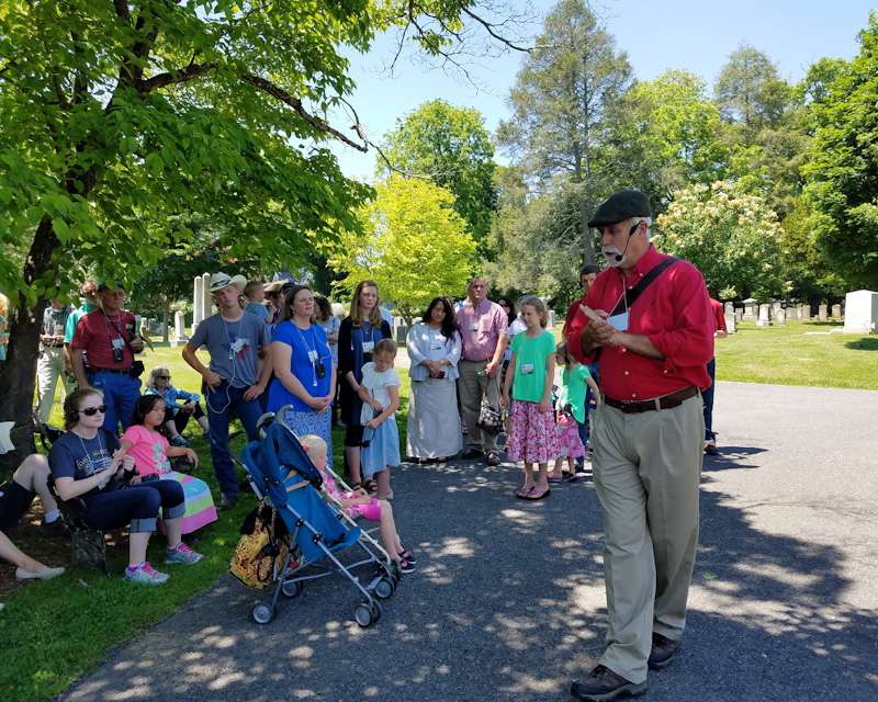 Bill Potter speaking to the Landmark tour group in the cemetery