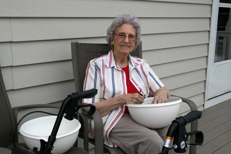 Granny on July 21st snipping green beans