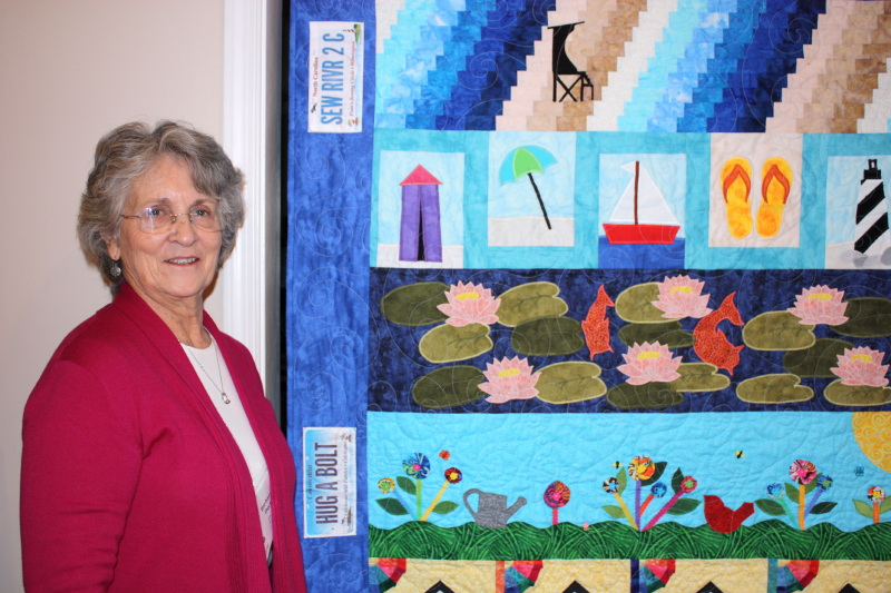 Chris' mom with her row along quilt