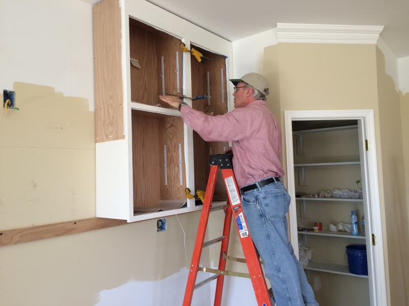 Tom installing the first two cabinets