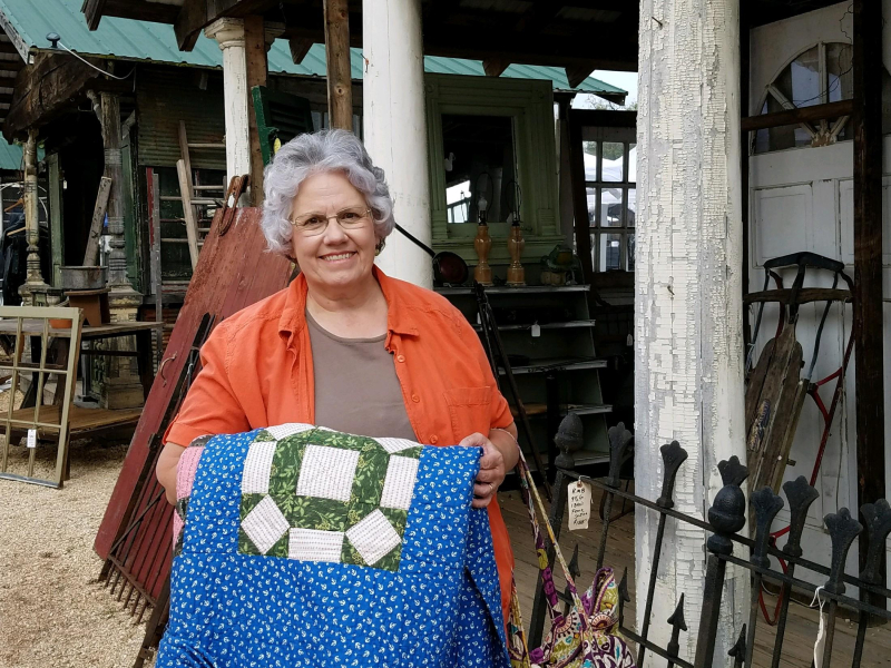 Deb with antique quilt