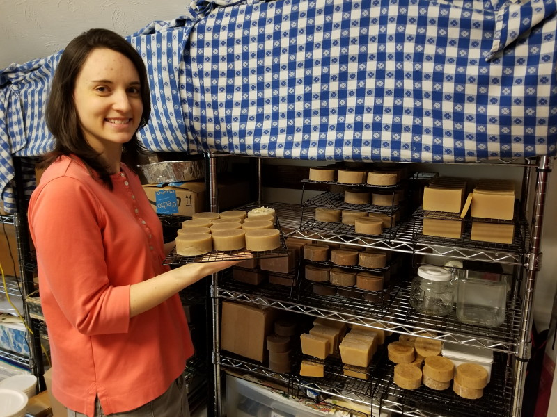 Hannah placing soap on the curing racks