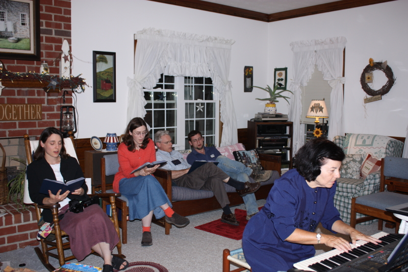 Carol on keyboard. Our family singing.