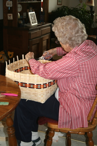 Granny making a large storage basket